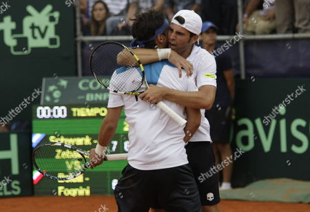 Stock Photo of Italian Simone Bolelli (r) and Fabio Fognini (l) Celebrate After Winning Against Argentine Eduardo Schwank and Horacio Zeballos During a Tennis Game As Part of Davis Cup in Mar Del Plata Argentina 01 February 2014 Argentina Mar Del Plata