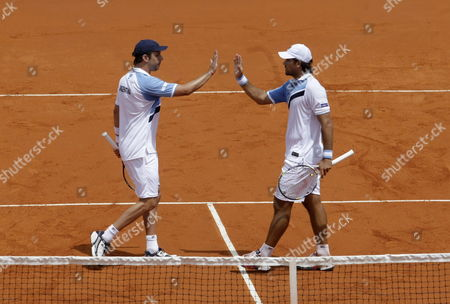 Stock Image of Argentina's Eduardo Schwank (l) and Horacio Zeballos (r) Celebrate a Point Against Italy's Simone Bolelli and Fabio Fognini During Their Doubles Match For the Davis Cup World Group Tie Between Argentina and Italy in Mar Del Plata Argentina 01 February 2014 Argentina Mar Del Plata