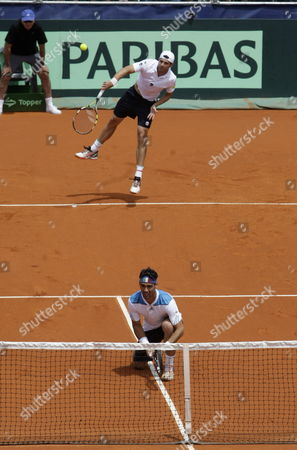 Italy's Simone Bolelli (rear) and Fabio Fognini (front) in Action Against Argentina's Eduardo Schwank and Horacio Zeballos During Their Doubles Match For the Davis Cup World Group Tie Between Argentina and Italy in Mar Del Plata Argentina 01 February 2014 Argentina Mar Del Plata