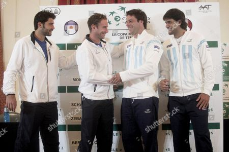 Italian Tennis Players Simone Bolelli (l) and Filippo Volandri (2-l) Greet Argentinian Players Horacio Zeballos (2-r) and Eduardo Schwank (r) During the Draw of the Davis Cup World Group First Round Tie Between Argentina and Italy in Mar Del Plata Argentina 30 January 2014 the Davis Cup First Round Tie Between Argentina and Italy Will Take Place From 31 January Until 02 February 2014 Argentina Mar Del Plata