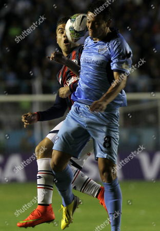 Jose Luis Chavez (r) De Bolivar of Bolivia Vies For the Ball with Hector Villalba of San Lorenzo of Argentina During the Second Leg of the Semifinal of the Libertadores Cup at Hernando Siles Stadium in La Paz Bolivia 30 July 2014 Bolivia La Paz
