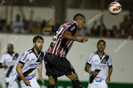 Luis Fabiano (c) of Sao Paulo Scores a Goal As Diego Sacoma (l) and Felipe Bastos (r) of Ponte Petra Look on During a Semi-final Match For Sudamericana Cup at Romildo Ferreira Stadium in Mogi Mirim Brazil 27 November 2013 Ponte Petra Will Play the Final of Sudamericana Cup Brazil Mogi Mirim