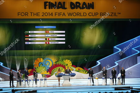 Fifa's General Secretary Jerome Valcke (5r) and Host Fernanda Lima (5l) During the Final Draw of the Preliminary Round Groups of the 2014 Fifa World Cup Brazil in Costa Do Sauipe Brazil 06 December 2013 Brazil Costa Do Sauipe