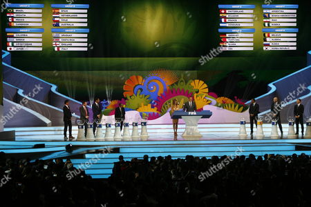 Brazilian Host Fernanda Lima (c-l) and General Secretary of Fifa Jeroma Valcke (c-r) During the Final Draw of the Preliminary Round Groups of the 2014 Fifa World Cup Brazil in Costa Do Sauipe Brazil 06 December 2013 Brazil Costa Do Sauipe