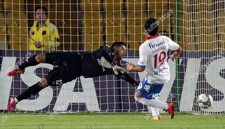 Santa Fe's Goalkeeper Camilo Vargas (l) Fails to Stop a Goal Scored by Nacional's Alejandro Nicolas Martinez (r) During Their Libertadores Cup Match at El Campin Stadium in Bogota Colombia 11 February 2014 Colombia Bogota