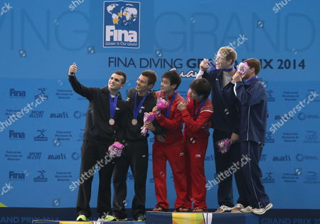 (l-r) Mexican Divers Ivan Garcia and German Sanchez (silver Medal) Chinese Liang Huo and Yanguan Zhang (gold Medal) and Us David Dinsmore and Steele Johnson (bronze Medal) Pose on the Podium During the Fina Diving Grand Prix in Guanajuato Mexico 17 May 2014 Mexico Guanajuato