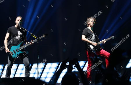 British Rock Band Muse's Singer Matt Bellamy (r) and Bass Player Christopher Wolstenholme Perform During a Concert As Part of Their Tour 'The 2nd Law World Tour' at Guadalajara Mexico 7 October 2013 Epa/ulises Ruiz Basurto Mexico Guadalajara