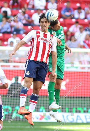 Stock Picture of Jes·s Aldo De Nigris (l) From Chivas Vies For the Ball with Javier David Mu±oz (r) From Jaguares During Their Match of the Apertura Tournament 2014 Held at the Omnilife Stadium in the City of Guadalajara Mexico 20 July 2014 Mexico Guadalajara