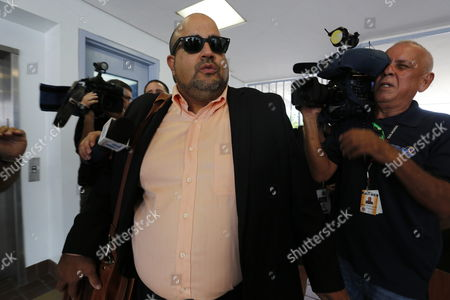 Edwin Prado One of Puerto Rican Singer Don Omar's Lawyers Arrives Handcuffed to Police Command Facilities in Bayamon Puerto Rico 17 September 2014 Don Omar was Arrested on Suspicion of Domestic Violence According to Media Reports Puerto Rico Bayamon