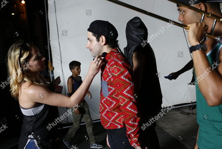 A Picture Made Available on 24 February 2014 Shows a Member of Puerto Rican Band Calle 13 Eduardo Cabra (c) Known As 'Visitante' Getting Preprared to Record Their Music Video 'Adentro' (lit:inside) in Caguas Puerto Rico 23 February 2014 Puerto Rico Caguas