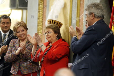 Stock Image of Chilean President Michelle Bachelet (c) Acknowledges Mps' Applause After Delivering a Speech Next to Speaker of Lower Chamber of Spanish Parliament Jesus Posada (r) and Deputy Speaker Celia Villalobos (2-l) at Spain's Lower House of Spanish Parliament in Madrid Spain 30 October 2014 Bachelet is on a Two-day Official Visit Iin Spain Spain Madrid