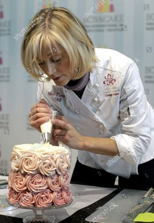 British Pastry Chef Mich Turner of the Little Venice Cake Company Works on a Wedding Cake During the Opening Ceremony of the Second International Fair of Creative Confectionery in Barcelona Spain 22 November 2013 the Event Runs Until 24 November Spain Barcelona
