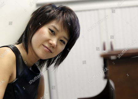 Chinese-born Pianist Yuja Wang Poses For Photographers During Her Interview to Spanish News Agency Efe in Madrid Spain 10 May 2014 Yuja Wang Will Close the Piano Season of La Maestranza Theatre in Sevilla with a Concert on 13 May 2014 Spain Madrid