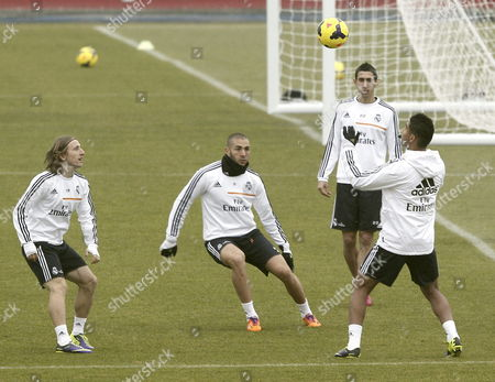(l-r) Real Madrid's Players Croatian Luka Modric French Karim Benzema Argentinian Angel Di Maria and Brazilian Carlos Henrique Casimiro Take Part in a Team's Training Session at Valdebebas Sport Complex Outside Madrid Spain 13 December 2013 to Prepare Their Primera Division League Match Against Osasuna at Pamplona's El Sadar Stadium on 14 December Spain Madrid