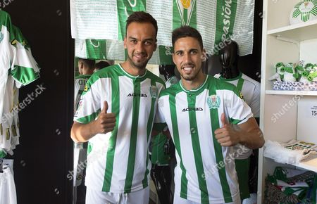 Spanish Soccer Players David Omar Rodriguez Barrera 'Deivid' (l) and Fidel Chaves De La Torre (r) Pose For Photographers During Their Presentation As New Players of Cordoba Cf in Cordoba Southern Spain 23 July 2014 Spain Cordoba