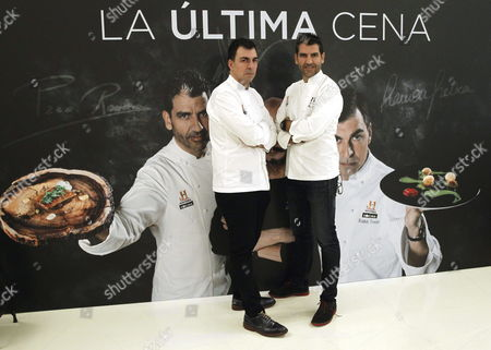 Spanish Chefs Ramon Freixa (l) and Paco Roncero (r) Both Distinguished with Michelin Stars Pose For Photographs During the Presentation of the Television Show 'The Last Supper' (spanish: La Ultima Cena) in Madrid Spain 02 April 2014 Spain Madrid