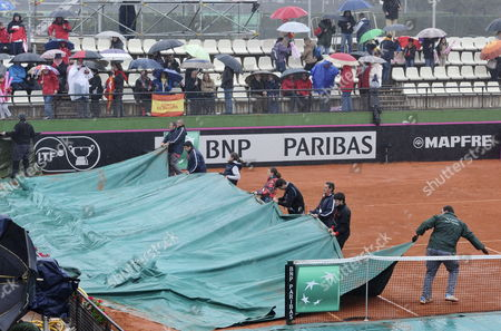 Volunteers Cover the Court Due to Rain During the Match Between Czech Tennis Player Klara Zakopalova and Spaniard Maria Teresa Torro For the Fed Cup World Group First Round Tie Between Spain and the Czech Republic in Seville Spain 09 February 2014 Spain Seville