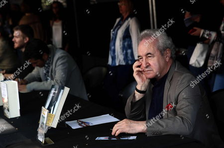 Irish Writer John Banville Signs Some Books on the Occasion of the Celebration of Saint George Festivity in Barcelona Northeastern Spain 23 April 2015 Catalonia Celebrates Saint George's Day Exchanging Books and Red Roses As Presents Spain Barcelona