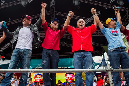 Officialist Candidate to Mayor of Caracas Ernesto Villegas (r) President of Venezuela National Assembly Diosdado Cabello (2-r) Officialist Candidate to Mayor of Libertador Municipality in Caracas Jorge Rodriguez (2-l) and Officialist Candidate to Sucre Municipality in Caracas Antonio Alvarez (l) Raise Their Arms During a Closing Campaign Event Before Local Elections in Caracas Venezuela 05 December 2013 Venezuela Will Holds Municipal Elections on 08 December to Elect 337 Mayors and Local Councils Venezuela Caracas