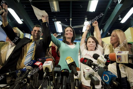 (l-r) President of Party Comite De Organizaci?n Politica Electoral Independiente (copei) Roberto Enriquez Former Legislator Maria Corina Machado Mitzy Capriles Wife of Imprisoned Mayor of Caracas Antonio Ledezma and Lilian Tintori Wife of Imprisoned Opposition Leader Leopoldo Lopez Participate in a Press Conference in Caracas Venezuela 23 February 2015 Party Copei Announced Its Support to the 'National Agreement Ahead the Transition' Promoted by Venezuelan Opposition Leaders Machado Ledezma and Lopez and Which is Considered by Government As an Evidence of a Conspiracy Venezuela Caracas