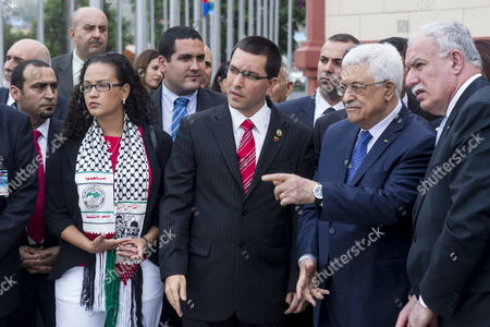 Stock Image of Palestinian Authority President Mahmoud Abbas (2-r) Palestinian Authority Foreign Minister Riyad Al-maliki (r) Venezuelan Vice President Jorge Arreaza (c) and Late Venezuelan President Hugo Chavez' Daughter Rosa Virginia Chavez (l) Visit the Cuartel De La Montana in Caracas Venezuela 16 May 2014 During His Visit Abbas Will Hold a Meeting with Venezuela President Nicolas Maduro at the Presidential Palace of Miraflores and Delivered the 'Palestine Star' Award to the Family of Late President Hugo Chavez Venezuela Caracas