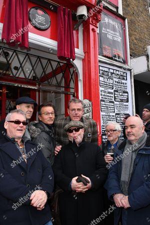 "Mike Barson, Mark Bedford, Dan Woody Woodgate, Graham "" Suggs "" McPherson, Lee Thompson, John Foreman, dad of Chris Foreman"