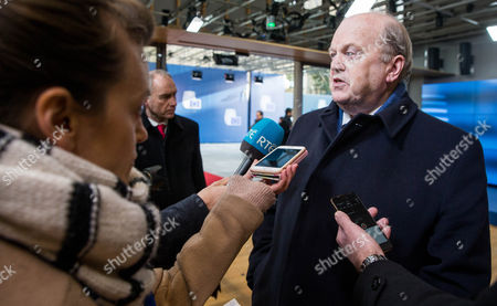 Irish Finance Minister Michael Noonan speaks to media as he arrives at the Eurogroup Finance Ministers meeting in Brussels, Belgium, 26 January 2017.