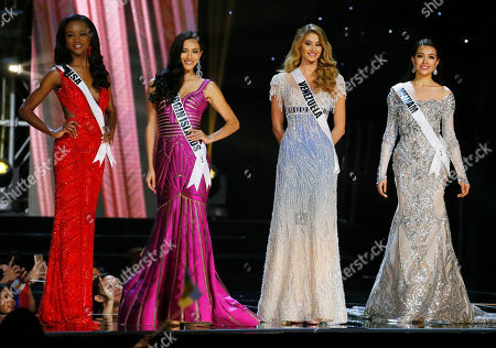 Deshauna Barber, Carolyn Carter, Mariam Habach, Le Hang Miss Universe contestants, from left, Deshauna Barber of the United States, Carolyn Carter of THE U.S. Virgin Islands, Mariam Habach of Venezuela and Le Hang of Vietnam, pose during the evening gown preliminary competitionof the Miss Universe beauty pageant at the Mall of Asia Arena in suburban Pasay city south of Manila, Philippines. A total of 86 contestants are vying for the title in the grand coronation on Jan. 30 to succeed Pia Wurtzbach of the Philippines