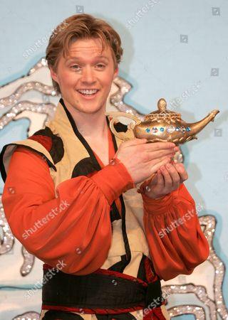 Neil Toon as Aladdin