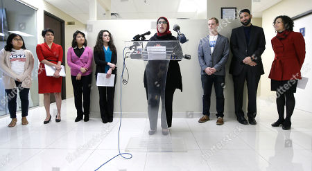 """Alia Salem, Melissa Hernandez, Michelle Garza, Liz Magallanes, Joe Swanson, Iman Omar Suleiman, Rabbi Nancy Kasten Alia Salem, center, executive director of the Dallas/Fort Worth chapter of the Council on American-Islamic Relations, leads a news conference with community activists concerning recent executive orders by President Donald Trump, in Dallas. Many U.S. Muslim and Latino advocates are unifying in opposition to executive actions taken by President Donald Trump to build a southern border wall and strip funding for """"sanctuary cities."""" Looking on from left, are Melissa Hernandez, Michelle Garza, Liz Magallanes, Nikiya Natale, Joe Swanson, Iman Omar Suleiman and Rabbi Nancy Kasten"""