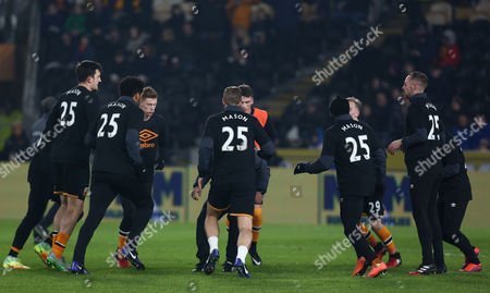 Hull City players warm up wearing shirts with the name of injured team mate Ryan Mason on during the EFL Cup Semi-Final second leg match between Hull City and Manchester United played at the KCOM Stadium, Hull, on 26th January 2017