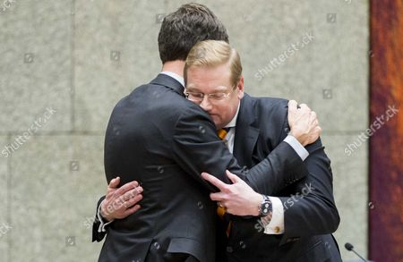 Dutch Minister of Safety and Justice Ard van der Steur (R) hugs with Prime Minister Mark Rutte after he resigned after a debate in the parliament, The Hague, The Netherlands, 26 January 2017. The debate was about the so-called Teeven deal - a deal then prosecutor Fred Teeven made with drug criminal Cees H. in 2000 that basically meant that H. got nearly 5 million guilders in return for paying a 750 thousand guilder fine. On 23 January, journalist Bas Haan revealed a hitherto secret email which shows that Van der Steur as parliamentarian advised that important information be withheld from the Tweede Kamer, the lower house of Dutch parliament.