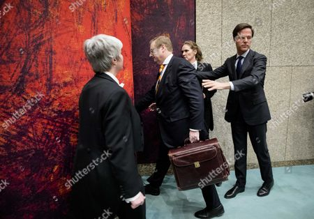 Dutch Minister of Safety and Justice Ard van der Steur (C) leaves with Prime Minister Mark Rutte (R) after he resigned after a debate in the parliament, The Hague, The Netherlands, 26 January 2017. The debate was about the so-called Teeven deal - a deal then prosecutor Fred Teeven made with drug criminal Cees H. in 2000 that basically meant that H. got nearly 5 million guilders in return for paying a 750 thousand guilder fine. On 23 January, journalist Bas Haan revealed a hitherto secret email which shows that Van der Steur as parliamentarian advised that important information be withheld from the Tweede Kamer, the lower house of Dutch parliament.