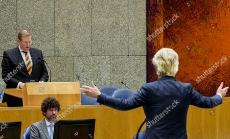 Dutch Minister of Safety and Justice Ard van der Steur (R) and PVV-leader Geert Wilders during the debate in the parliament, The Hague, The Netherlands, 26 January 2017. The debate was about the so-called Teeven deal - a deal then prosecutor Fred Teeven made with drug criminal Cees H. in 2000 that basically meant that H. got nearly 5 million guilders in return for paying a 750 thousand guilder fine. On 23 January, journalist Bas Haan revealed a hitherto secret email which shows that Van der Steur as parliamentarian advised that important information be withheld from the Tweede Kamer, the lower house of Dutch parliament.