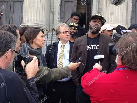 Robert Jones, right, speaks with reporters, with defense attorneys Emily Maw, left, and Barry Scheck, at the New Orleans courthouse, . Prosecutors formally dropped charges Thursday against Jones who spent more than 20 years behind bars for a 1992 crime spree that included the slaying of a British tourist
