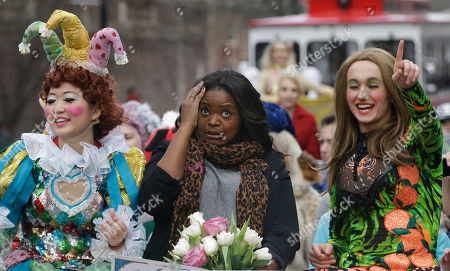 Guan-Yue Chen, Hasty Pudding Theatricals President, left, and Dan Milashewski, vice president, right, ride with actress Octavia Spencer during a parade to honor Spencer as the Hasty Pudding Theatricals Woman of the Year, in Cambridge, Mass
