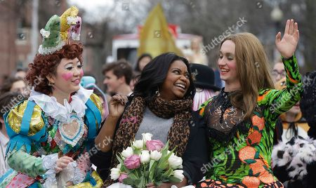 Stock Photo of Guan-Yue Chen, Hasty Pudding Theatricals President, left, and Dan, Milashewski, vice president, right, ride with actress Octavia Spencer during a parade to honor Spencer as the Hasty Pudding Theatricals Woman of the Year, in Cambridge, Mass