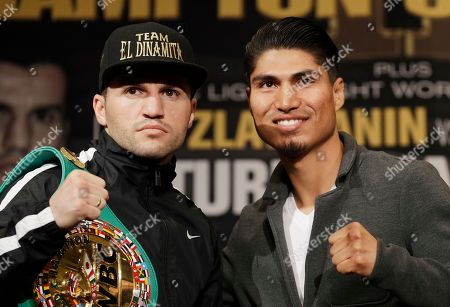 Dejan Zlaticanin, left, of Montenegro, and Mikey Garcia, of the U.S., pose for photographers during a news conference, in Las Vegas. The two are scheduled to fight in a lightweight title boxing match Saturday in Las Vegas