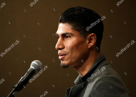 Mikey Garcia speaks during a news conference, in Las Vegas. Garcia is scheduled to fight Dejan Zlaticanin, of Montenegro, in a lightweight title boxing match Saturday in Las Vegas