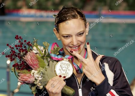 Virginie Dedieu of France Poses with Her Gold Medal After Winning For the Third Time in a Row the Synchronized Swimming Solo Routine Final at the Susie O'neill Pool at the Fina Swimming World Championships in Melbourne Australia Thursday 22 March 2007 Australia Melbourne
