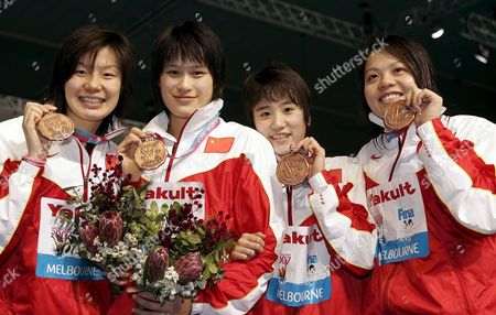 (l-r) Longzi Xutian Nan Luo Yafei Zhou and Yanwei Xu of the Chinese Relay Team Show Their Bronze Medals After the Award Ceremony For the Women's 4x100m Medley Relay in the Susie O'neill Pool at the Fina Swimming World Championships in Melbourne Australia Saturday 31 March 2007 Australia Melbourne