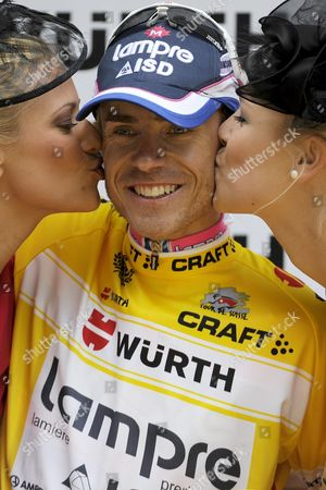 Italy's Damiano Cunego of Team Lampre-isd the Overall Leader is Kissed by Former Miss Switzerland Christa Rigozzi Left and Former Miss Switzerland Linda Faeh Right After the 7th Stage a 222 8 Km Race From Vaduz in Liechtenstein to Serfaus-fiss-ladis in Austria at the 75th Tour De Suisse Uci Protour Cycling Race in Serfaus-fiss-ladis Austria June 17 2011 Austria Serfaus-fiss-ladis