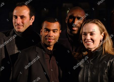 Former Swiss Tennis Player Martina Hingis (r) Arsenal Player Sol Campbell (2nd R) Arsenal Player Ashley Cole Third From Right and Swiss Former Soccer Player Ramon Vega (l) Pose For the Media As They Promote the United Nation's 'Year of Sport 2005' Monday 13 December 2004 Switzerland Schweiz Suisse London