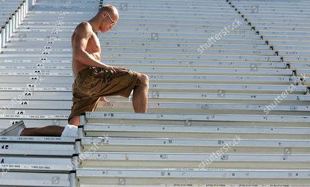 Australia's Michael Klim Stretches in the Stands During Practice at the Fina World Championships in Montreal Canada Saturday 23 July 2005 Swimming Competion Begins Sunday 24 July 2005 Canada Montreal