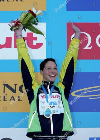 Australia's Giaan Rooney Celebrates on the Victory Stand After Winning the Gold Medal in the Women's 50m Backstroke at the Fina World Championships in Montreal Canada Thursday 28 July 2005 Canada Montreal