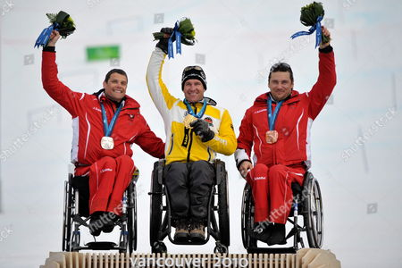 From Left to Right Silver Medalist Jurgen Egle From Austria Gold Medalist Martin Braxenthaler From Germany and Bronze Medalist Philipp Bonadimann From Austria Celebrate During the Medals Presentation of the Men's Super Combined Sitting of the 2010 Vancouver Winter Paralympics at Whistler Creekside on March 20 2010 in Whistler Canada Canada Whistler