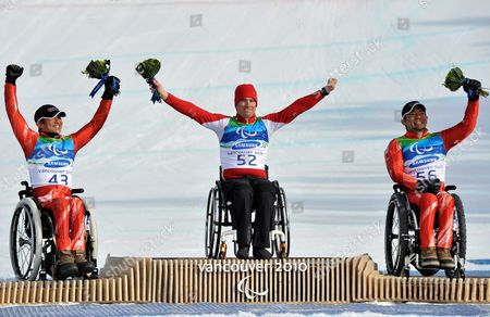 (l-r) Silver Medalist Taiki Morri of Japan Gold Medalist Christoph Kunz of Switzerland and Bronze Medalist Akira Kano of Japan Celebrate on the Podium After the Men's Downhill Sitting of the 2010 Vancouver Winter Paralympics at Whistler Creekside on 18 March 2010 in Whistler Canada Canada Whistler
