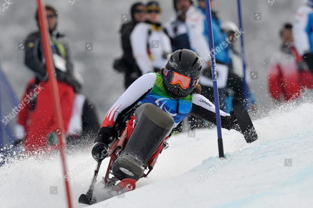 Austrian's Claudia Loesch Passes a Gate During the First Run of the Women's Slalom Sitting of the 2010 Vancouver Winter Paralympics at Whistler Creekside in Whistler Canada on 14 March 2010 Canada Whistler