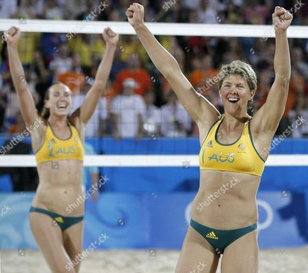 Natalie Cook (r) and Tamsin Barnett of Australia React After Winning the Womens Beach Volleyball Preliminary Pool C Match Against Cristine Saka and Andrezza Rtvelo of Georgia at the Beijing 2008 Olympic Games in Beijing China August 11 2008 China Beijing