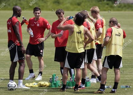 Switzerlands's National Soccer Players (from Left) Johann Djourou Blerim Dzemaili Xavier Margairaz Hakan Yakin Patrick Mueller Stephane Grichting and Mauro Lustrinelli Drink Water During a Training Session in the Ussbachtal Stadium in Bad Bertrich Germany Wednesday June 14 2006 Switzerland Plays in Group G at the Fifa 2006 Soccer World Cup in Germany Against the Teams of France South Korea and Togo Germany Bad Bertrich